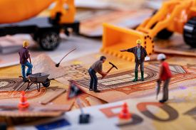 Construction Business Concept - Workers Team Working Hard To Earn More Money