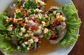 Raw Mud-crab In Fish Sauce And Thai Recipe Spicy Sauce Topping.