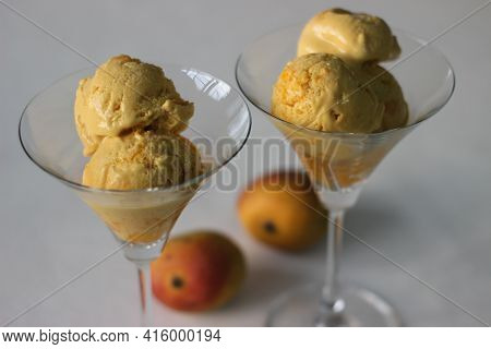Scoops Of Home Made Mango Ice Cream Served In Cocktail Glass Along With Fresh Cut Lalbagh Mangoes.
