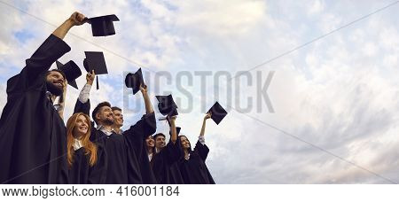 Millennial Students Celebrating Graduation Ceremony And Throwing Their Caps Up. Young People On Comm