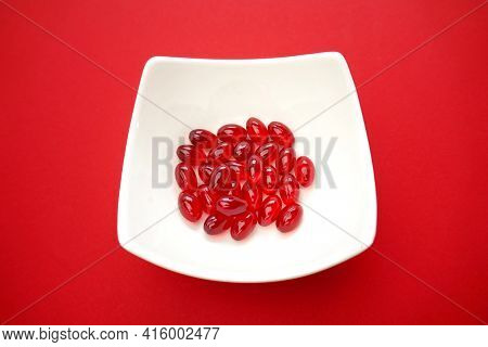 Krill Oil Gelatin Capsules Close-up.omega Fatty Acids.natural Supplements And Vitamins.red Capsules