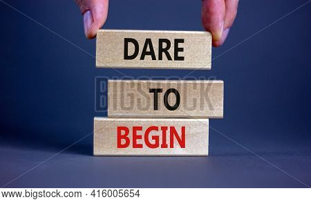 Dare To Begin Symbol. Wooden Blocks With Words 'dare To Begin'. Beautiful Grey Background, Businessm