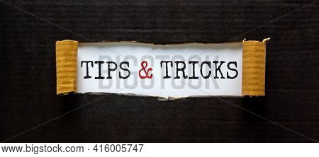 Tips And Tricks Symbol. Words 'tips And Tricks' Appearing Behind Torn Black Paper. Beautiful Black B