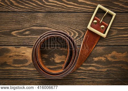 Mens Wide Brown Belt Made Of Genuine Leather With A Buckle For Jeans On A Wooden Background, Genuine