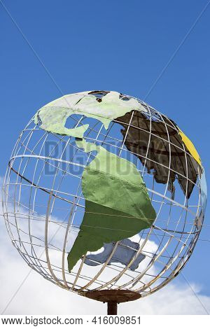 Tupiza, Bolivia - 28/12/2014: Metal Sculptured Globe Of The Planet Earth With Highlight On South Ame
