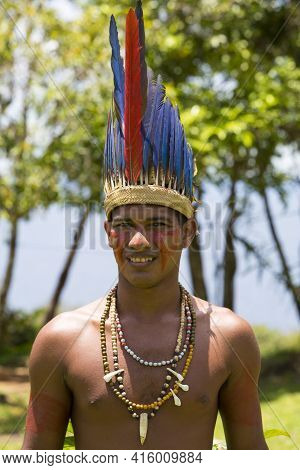 Manaus, Brazil, March 25, 2016: Brazilian Indian Man Wearing The Feathers Hat From Tribe Ritual In A