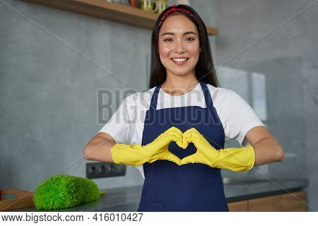 Love To Clean. Cheerful Young Woman, Cleaning Lady Wearing Protective Gloves, Smiling At Camera, Sho