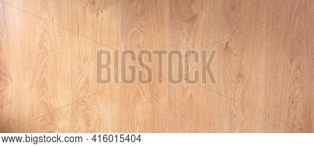 Laminate floor background texture. Wooden laminate floor or wood table top with copy space