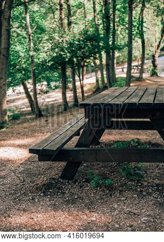 Picnic Table In The Park. Table Background Of Free Space For Your Decoration And Blurred Landscape O