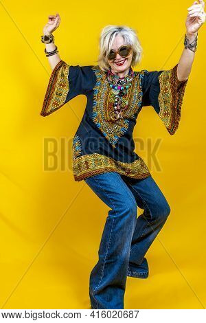 Funny Portrait Of Mature Woman. Beautiful Lady Have Fun Dressed With Seventies Costume. Mature Woman