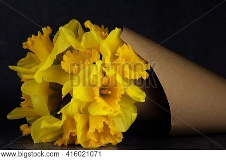 A Beautiful Bouquet Of Wild Daffodils (narcissus Pseudonarcissus) In A Paper Cone.