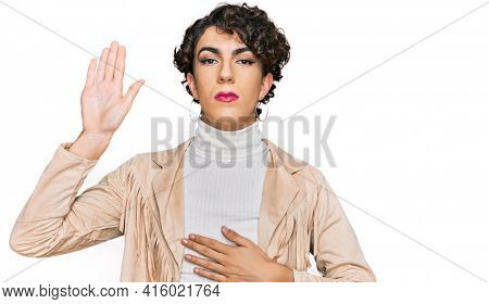 Handsome man wearing make up and woman clothes swearing with hand on chest and open palm, making a loyalty promise oath