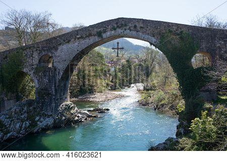Beautiful Bridge Over Sella River At Cangas De Onis, Asturias. Roman Bridge, Sunny Day And No People