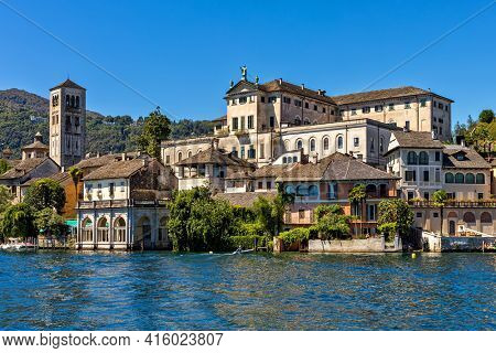 View of old abbey and monastery on San Giulio island on Lake Orta in Piedmont, Northern Italy.