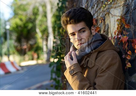 Attractive Young Handsome Man, Model Of Fashion In A Park