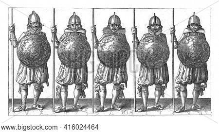 The exercise with shield and spear: five soldiers standing side by side in ranks with the spear resting in the right hand on the ground and the shield in front of the chest, vintage engraving.