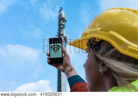 5g Network. Mobile Internet Radio Antenna. Radio Tower. Radio Waves And The Internet. Engineer Woman