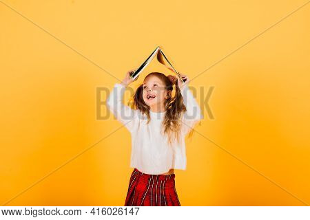 Happy Surprised Beautiful Little Child Girl Looking To Camera On Grey Background. Human Emotions And
