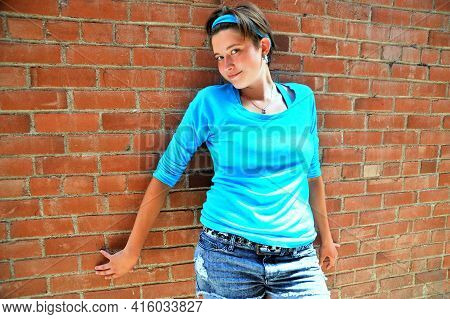 Female Beauty Fashion Model Expressions Against A Wall Outside.
