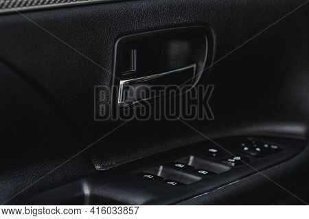 Modern Car Interior Door Handle Close Up. Metallic Car Door Opener Handle Inside.