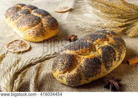 Rustic Bread. Fresh Loaf Of Rustic Traditional Bread With Poppy Seeds, Wheat Grain Ear On Linen Text