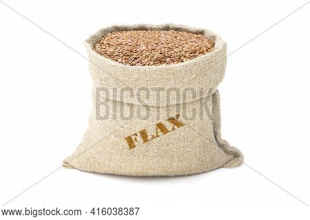 Seeds Of Flax In A Sack Of Isolated On A White Background. Flax In A Burlap Sack. Healthy Food. Flax