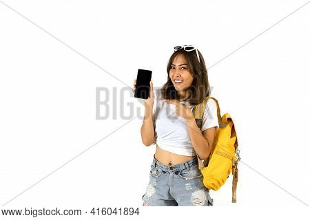 An Asian Woman Tourist Carrying A Yellow Backpack And Pointing Her Finger At The Smartphone In Her H
