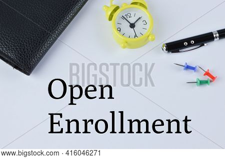 Office Tools Over White Background Written With Open Enrollment. A Business Concept.