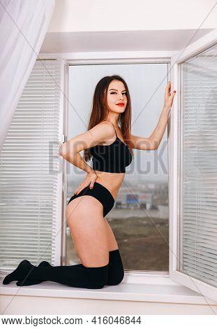 Beautiful Brunette Woman Posing In Black Underwear. Girl Relaxed. Sensual Girl Wear Underwear. Tight