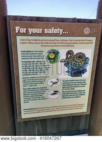 Dinosaur Provincial Park, Alberta, Canada - April 5th, 2021: A Sign Warning Of Rattlesnakes, Scorpio