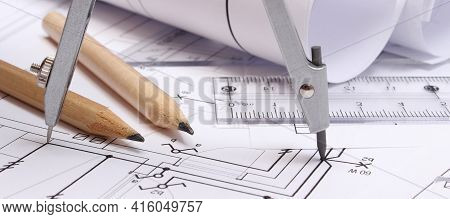 Rolled Electrical Diagrams And Accessories For Drawing Lying On Construction Drawing Of House. Drawi