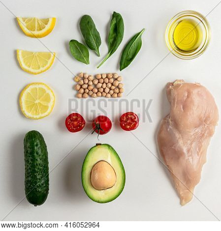 Raw Ingredients For Dietary Salad With Chicken, Avocado, Cucumber, Tomato And Spinach