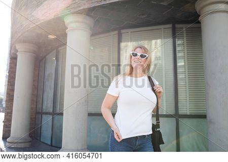 White t-shirt streetwear women's plus size fashion apparel outdoor shoot
