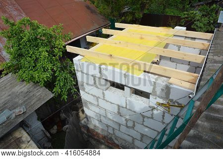 Building Home Addition From Autoclaved Aerated Concrete Blocks. Installing Wooden Ceiling Joists  An