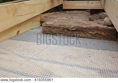 Roofing Insulation: A Close-up Of Roof Mineral Wool, Glass Wool Insulation Over A Vapor Barrier, Mem