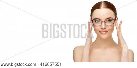 Woman in glasses. Fashion model in eyeglasses. Correction of vision. Advertising optics and eye products.