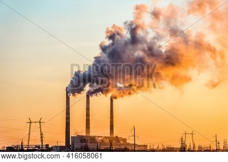 Sunset Over The Industrial City.factory Chimneys Smoke.environmental Problem Of Environmental And At