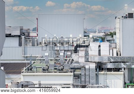 Air Flow System Of Factory. Industrial Ventilation. Air Flow System On Roof Deck Of Manufacturing Bu