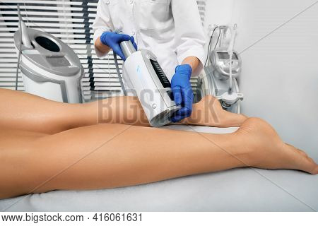 Endospheres Therapy. Woman Gets Endospheres Therapy And Massage For Legs. Anti-cellulite Massage