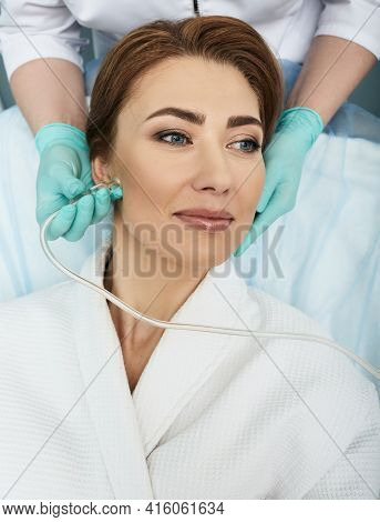 Close-up Of A Womans Face During Ozone Therapy Procedure. Beautician Treats Female Skin For Rosacea,