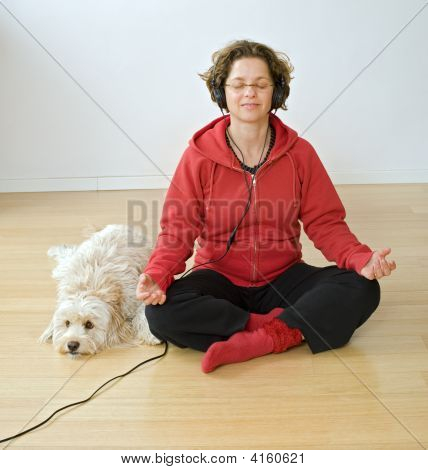 woman meditating with headphones and her dog poster