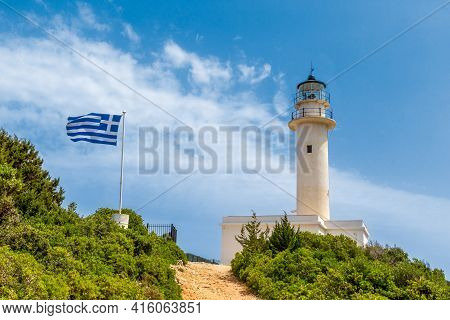 Picturesque Lighthouse On Top Of Cape Lefkata, Cape Doukato, On The Ionian