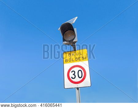 International Traffic Sign 'speed Limit To 30' (km Or Miles), Writing 'school District' (in Turkish)