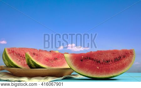 Watermelon Slices Summer Fruit Concept. Red Fresh Sweet Healthy Ripe Watermelon In Plate On Wooden T