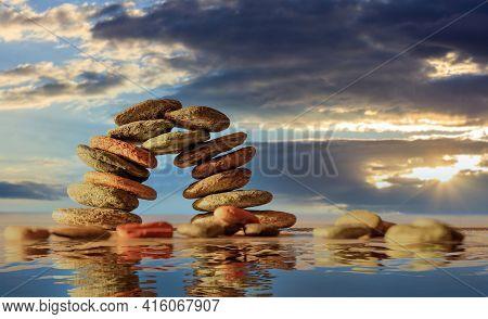 Zen Stones Bridge Stack On Cloudy Sky And Sea Background.