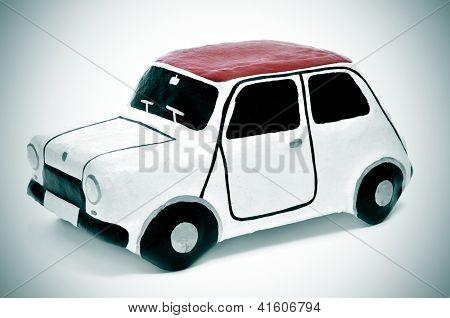 closeup of a papier-mache toy car
