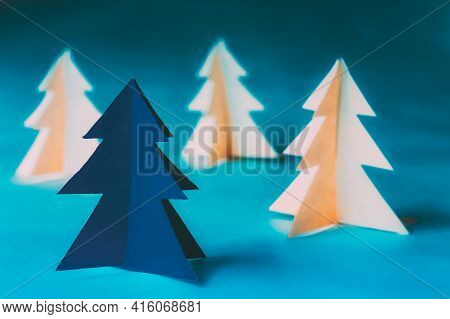 Eco Concept Christmas Trees Made From Paper. Winter Holiday Card. Simple Minimalist Paper Decoration