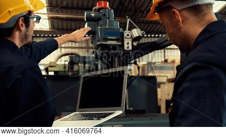 Skillful Factory Worker Working With Laptop Computer To Do Procedure Checklist . Factory Production