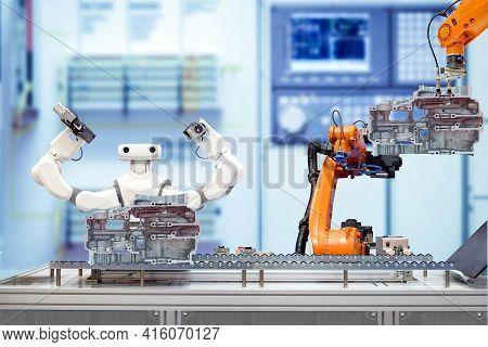 Industrial Robotic Teamwork Working With Engine Parts Of Motorbike Via Conveyor On Blurred Smart Fac