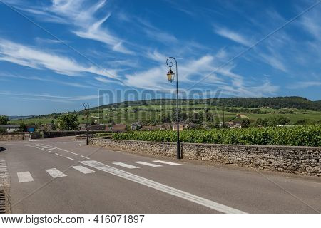 View To The Road And Vineyard In Burgundy Bourgogne Home Of Pinot Noir And Chardonnay In Summer Day